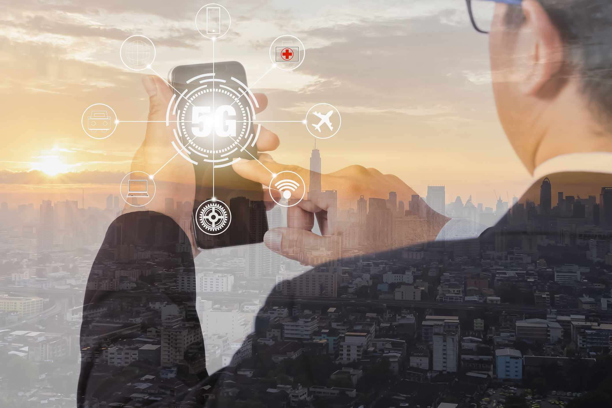 Double exposure, businessperson use smartphone with 5G network twilight in the morining bigcity overlay background.