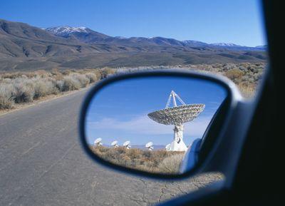 satellite dish in side-mirror of car