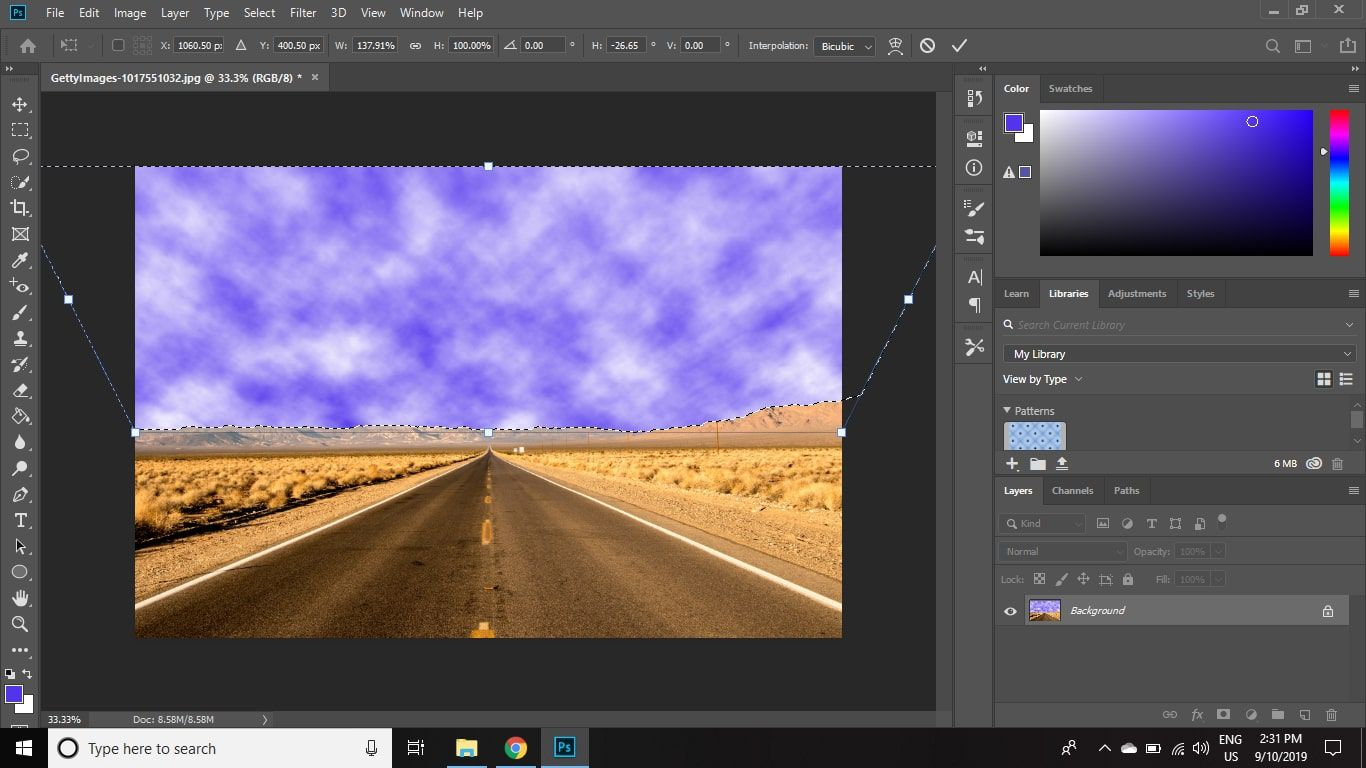 Click and drag the handle in the top-left corner to the left to make the clouds look like they are rolling in as the perspective changes.