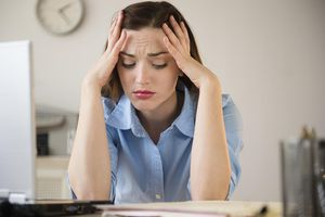 Businesswoman frustrated at work