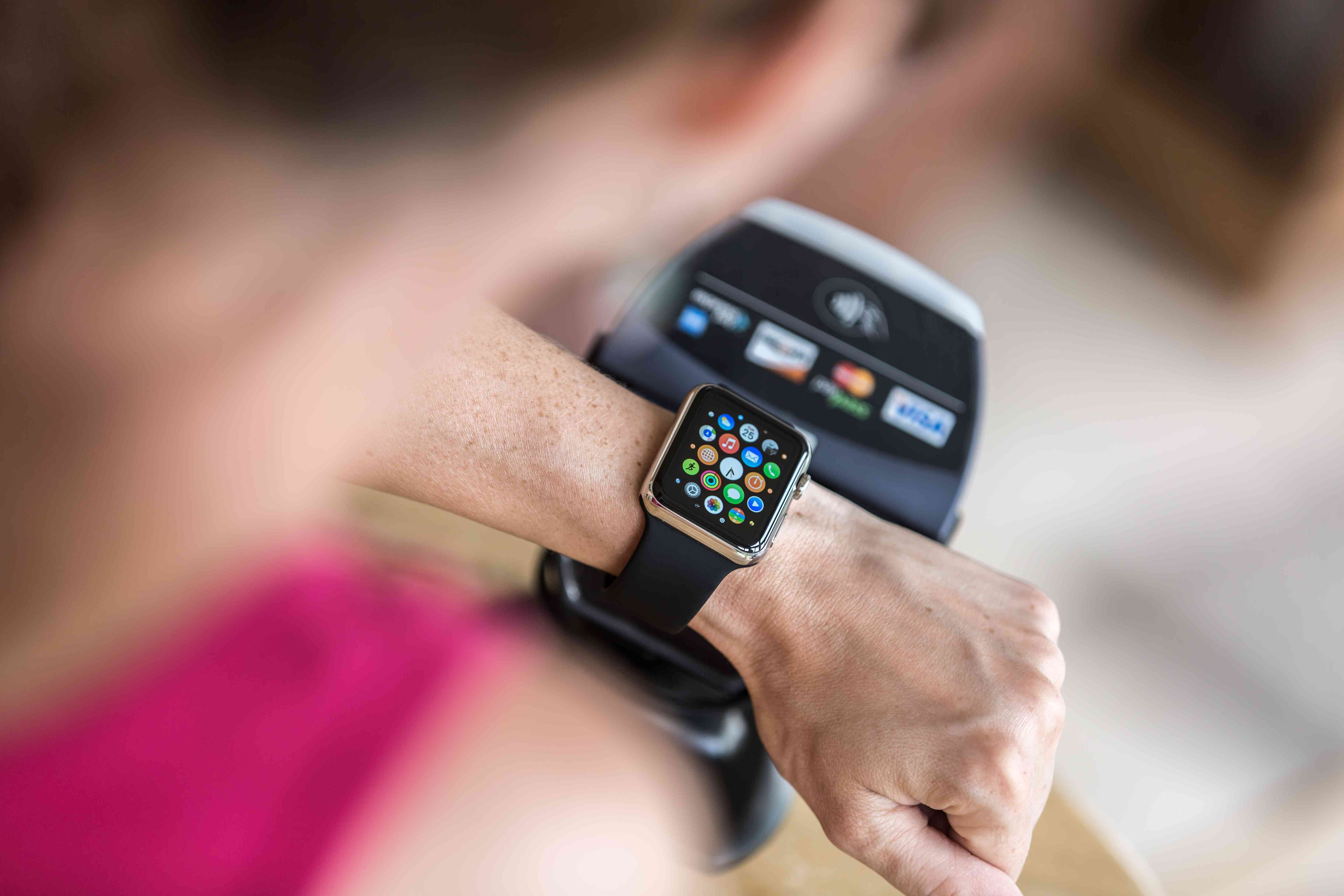 Woman Paying using Apple Watch and Apple Pay