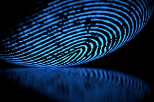Large fingerprint glowing blue