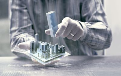 Illustration of augmented reality with man holding 3D diagram