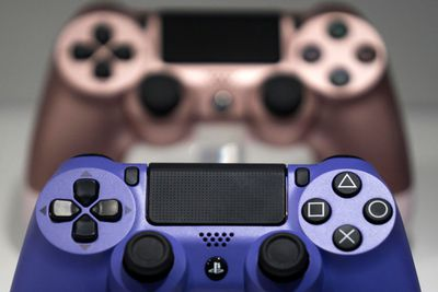 Wireless controller for the PlayStation 4 (PS4) game console on display at the Tokyo Game Show 2019.