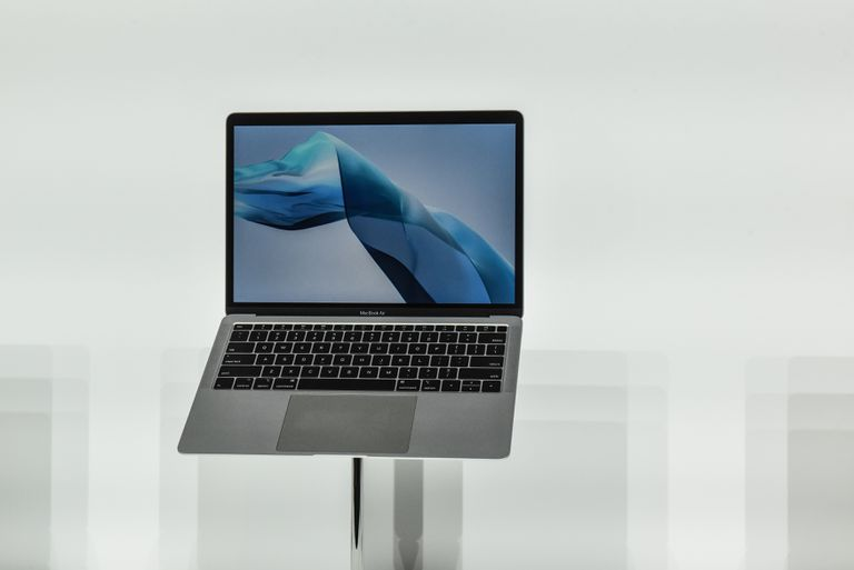 A MacBook Air on a display stand.