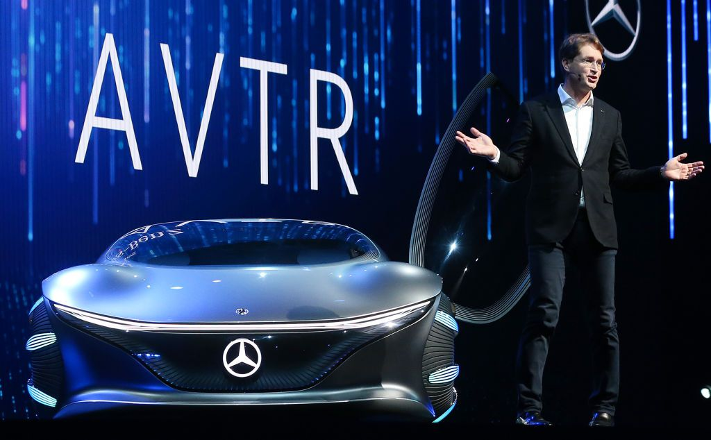 A Mercedes AVTR concept on stage with host explaining its features