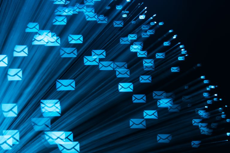 Network Communications represented by digital email letters flying through the air