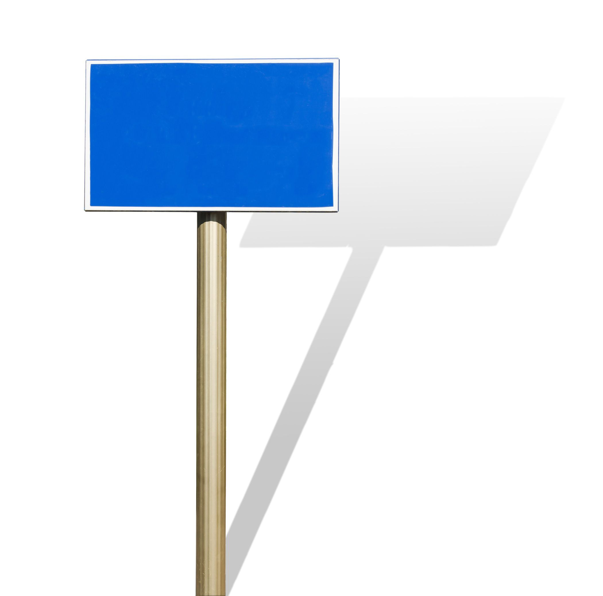 A blue sign on a pole casts a shadow on a white background.