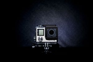 Rear view of a silver GoPro Hero 4 Camera