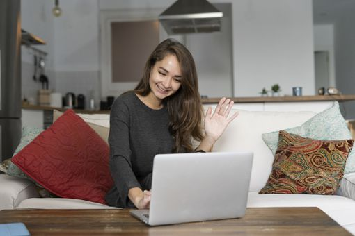 Woman video conferencing on laptop