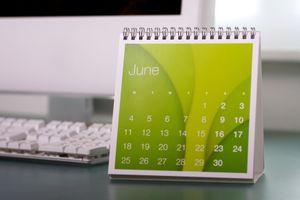 Calendar next to an Apple keyboard