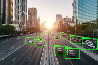 Cars on a highway with boxes simulating the view of a driverless car with artificial intelligence.