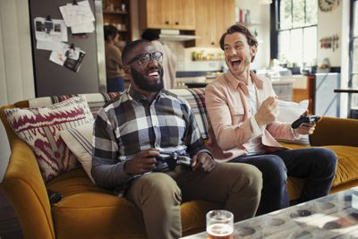 Two friends playing video games