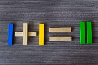 Wooden blocks that show I + I = II