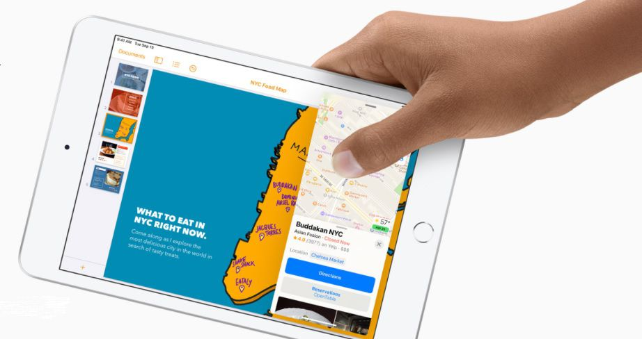 iPad Air with hand holding it to show small size in comparison to hand.