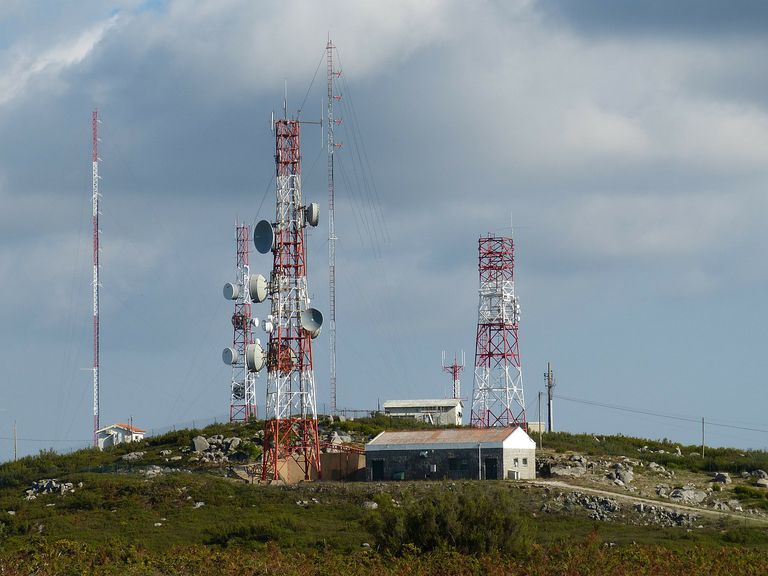 An image of TV antennas on a mountain.