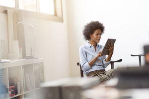 Businesswoman using iPad