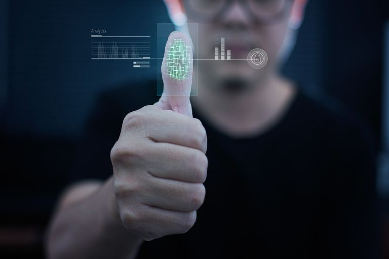Picture of a man scanning his fingerprint on a scanner
