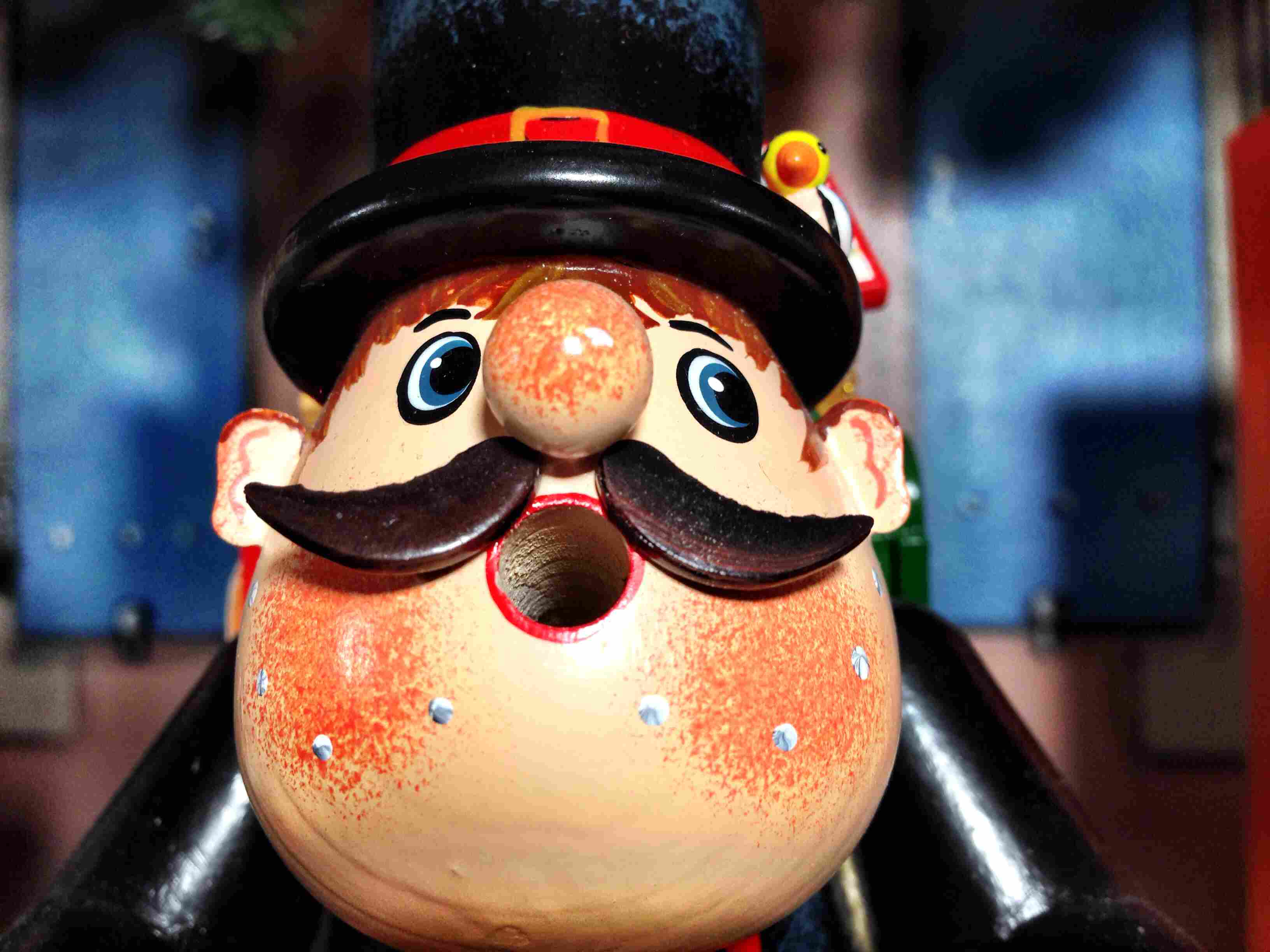 Wooden doll with top hat and mustache with a surprised face