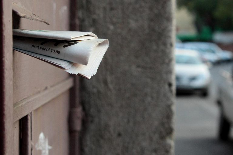 Mail hanging out of a mail box