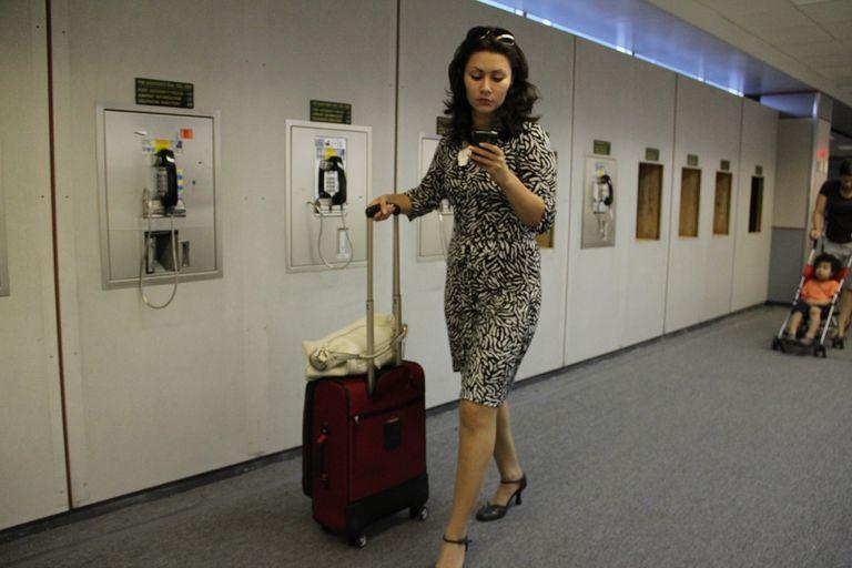 Business traveler on her phone