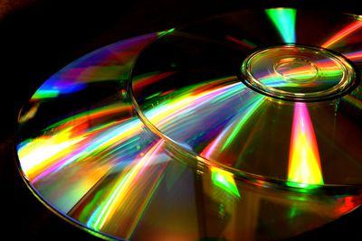 Two optical discs laid atop each other