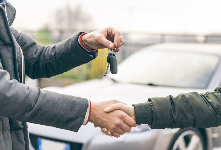 A man handing over his keys