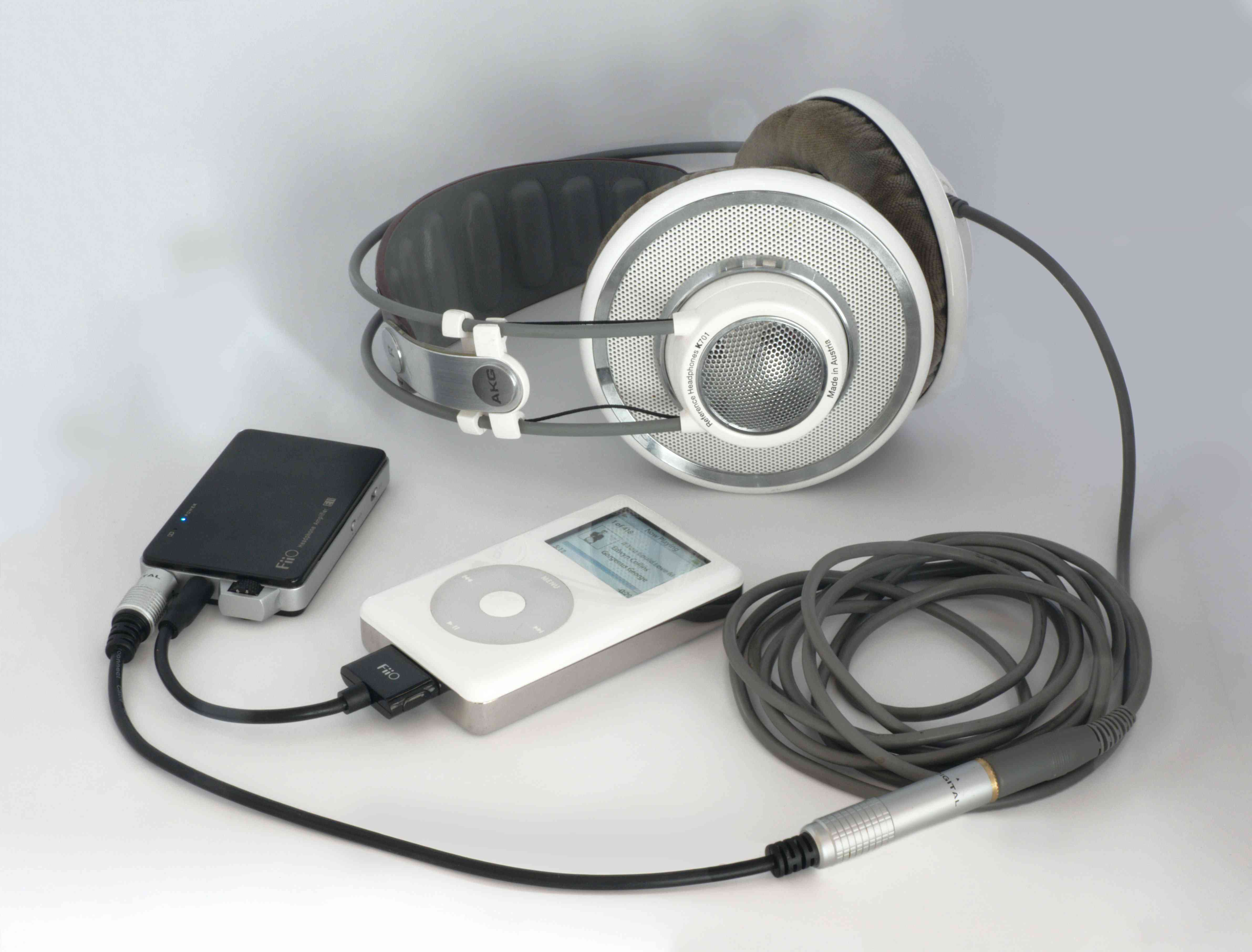 An original iPod classic with an adapter to be able to connect professional grade headphones.