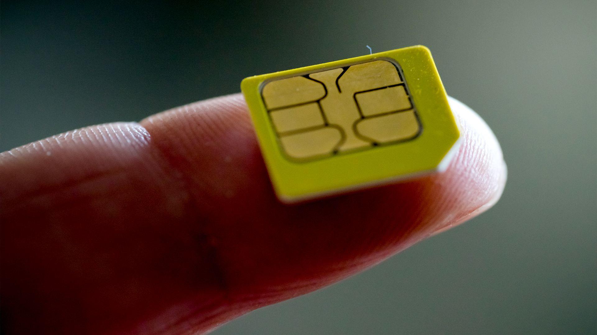 A SIM card on a finger.