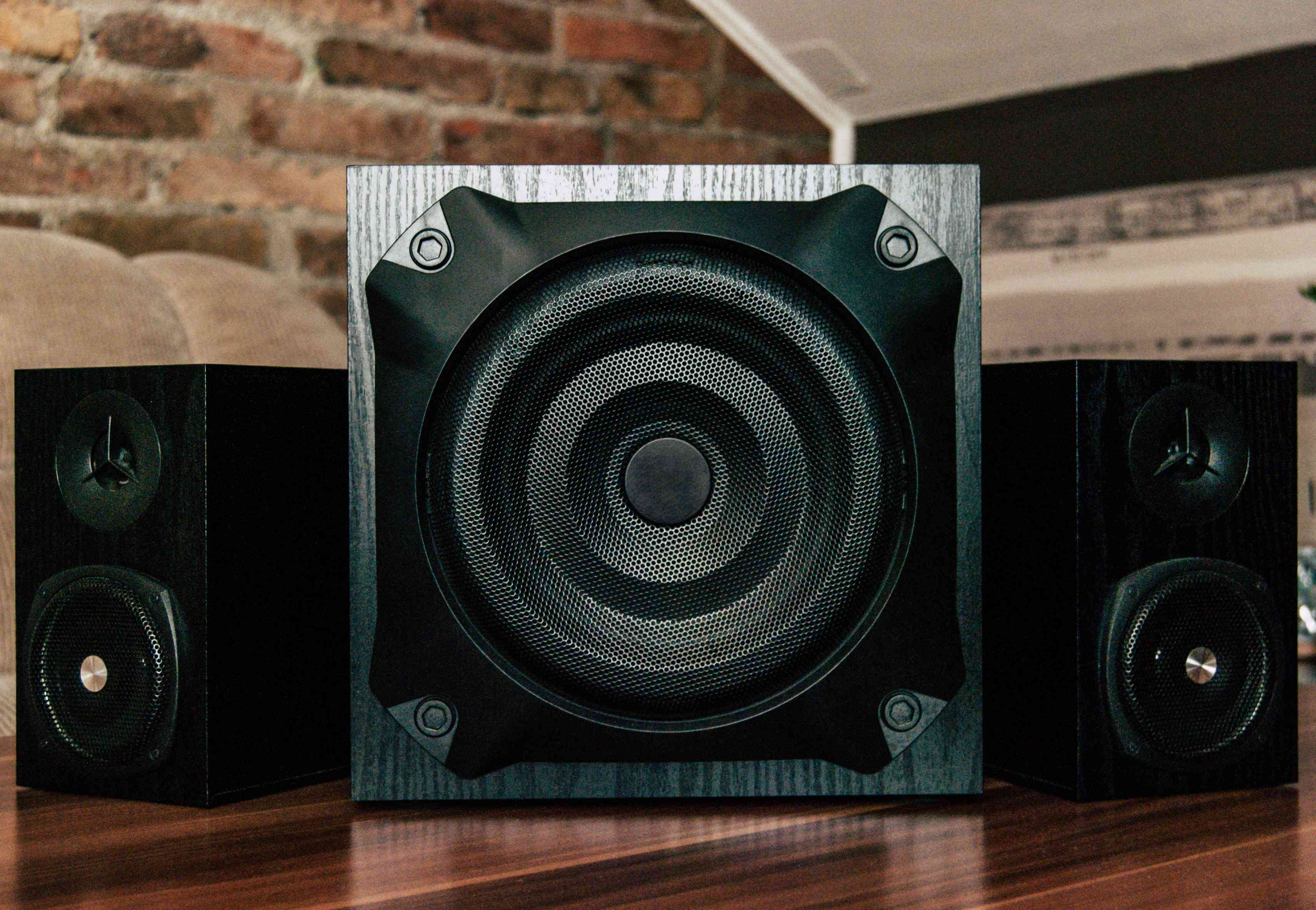 Black sub-woofer and two speakers
