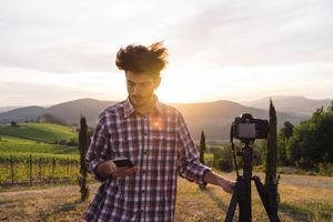 A photographer uses the Canon Camera Connect app to take a photo remotely.