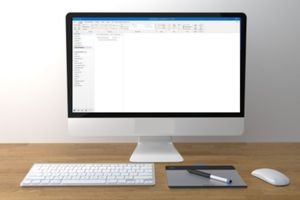 Desktop computer showing white screen.