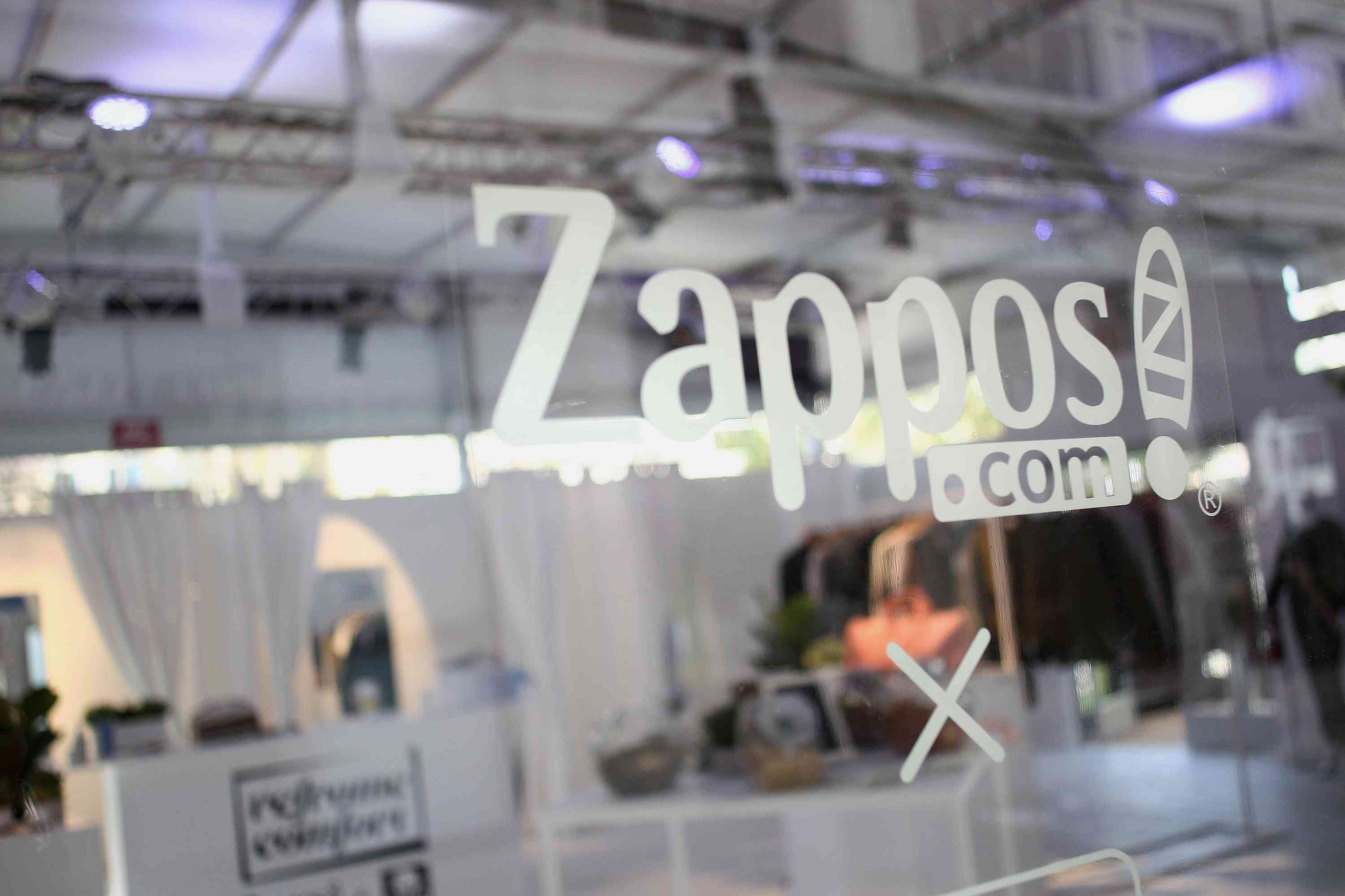An image of the Zappos logo on a glass door.
