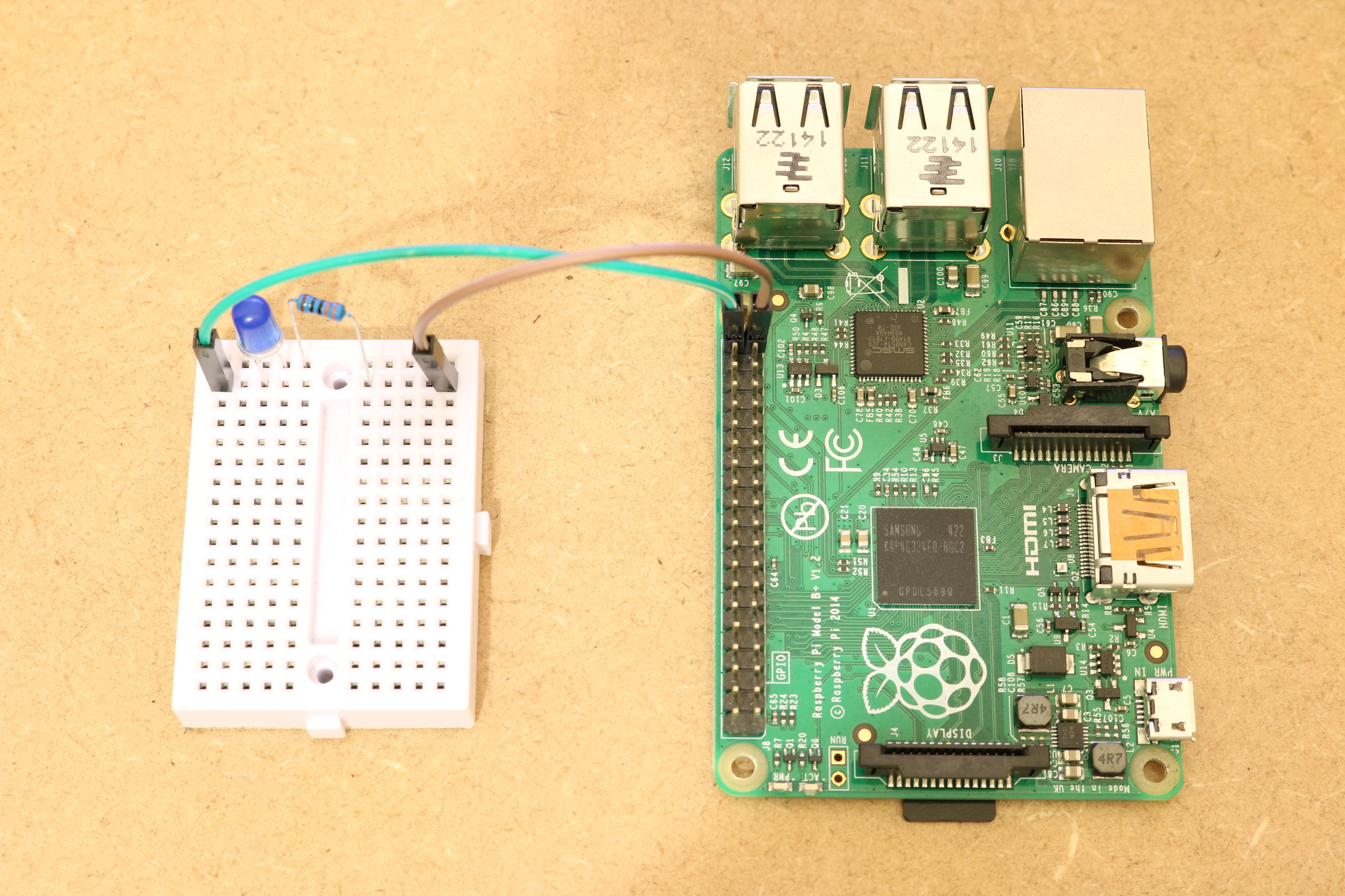 Full circuit with LED and resistor fitted on Raspberry Pi's GPIO