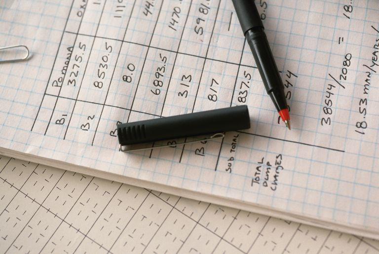 Industrial Designer's Pen and Handwritten Spreadsheet