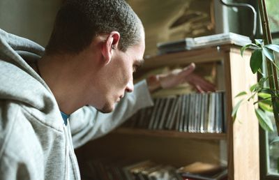 Man looking at CDs on a shelf