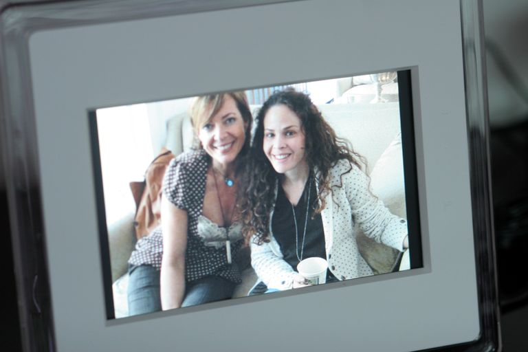 Digital picture frame featuring image of two women smiling