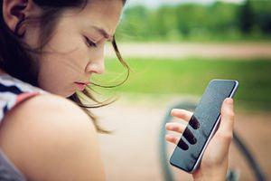 Girl looking at damaged phone