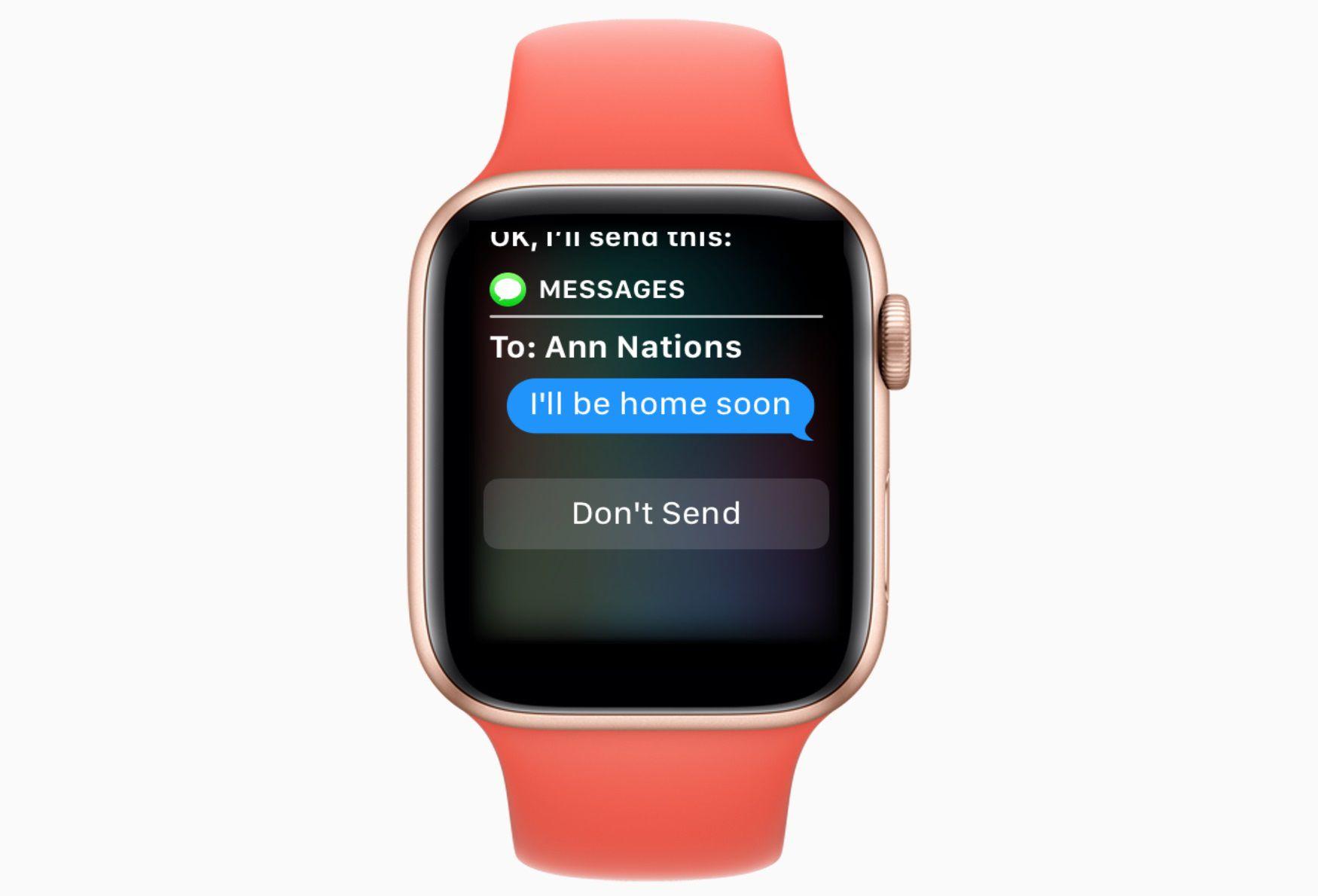 An Apple watch with Siri sending a text message.