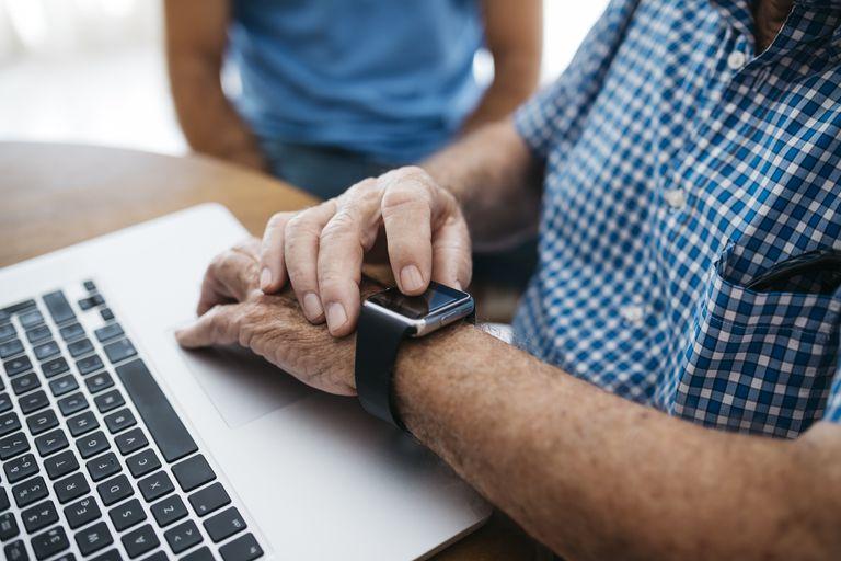 Senior man using smartwatch, close-up