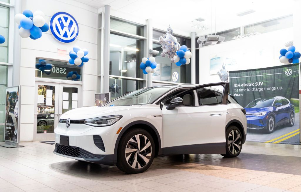 The all-electric Volkswagen ID.4 on display inside a dealership.