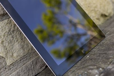 iPad outside with the reflection of a tree