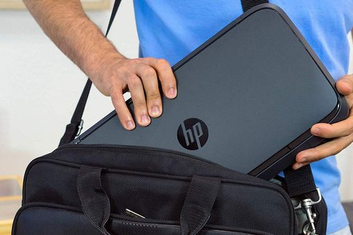 Man putting HP OfficeJet 200 Portable Printer into his bag