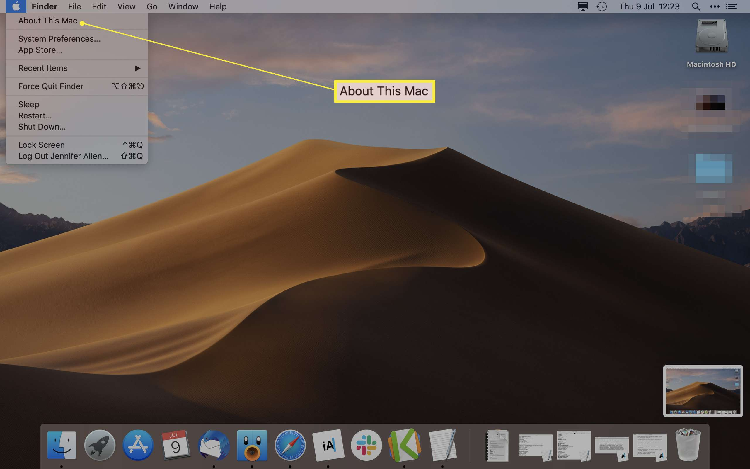 MacOS desktop screen with About This Mac highlighted