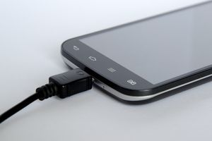 Smartphone plugged in to charge