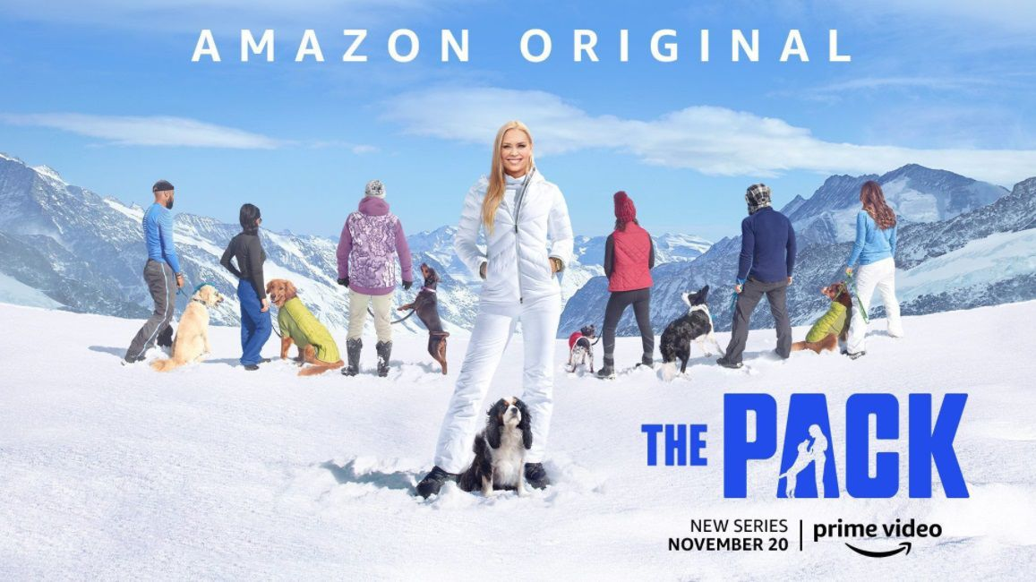 Dogs and their owners on a snowy mountain in The Pack