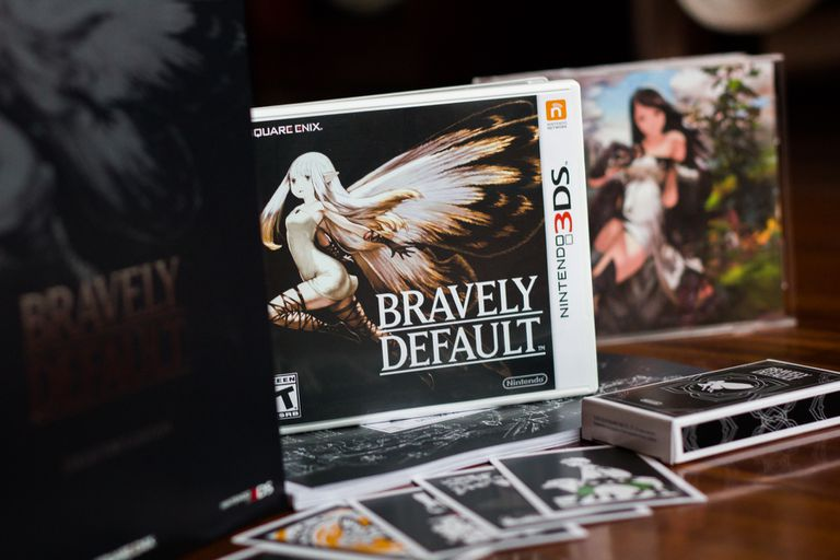 Bravely Default video game next to cards