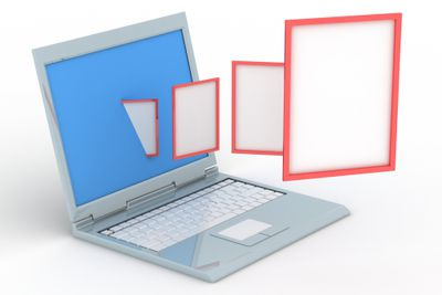 Laptop with files flying out