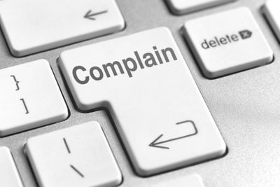 Image of a keyboard with a large Complain button
