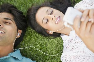Mixed race couple listening to mp3 player together